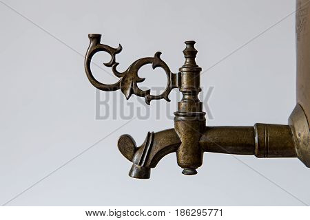 faucet of old vintage bronze samovar closeup