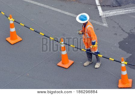 Road Construction Worker On City Street