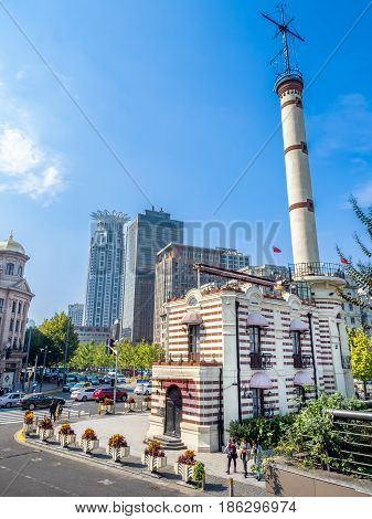 Shanghai, China - Nov 4, 2016: Along The Bund Sightseeing Avenue, featuring the Old Shanghai Weather Station. Area is popular with local and foreign visitors.