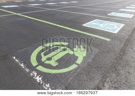 Fishers - Circa May 2017: In an effort to make Electric Charging available for employees companies are repurposing Handicap Parking as EV Charging spots III