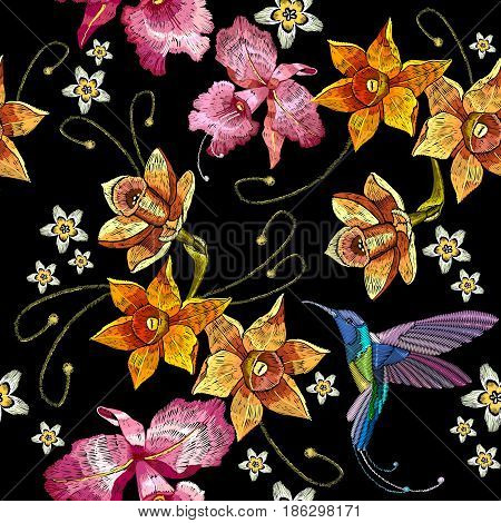 Humming bird orchid exotic tropical flowers seamlees pattern. Beautiful classical embroidery humming-bird orchids tropical flowers. Template for clothes embroideries t-shirt design
