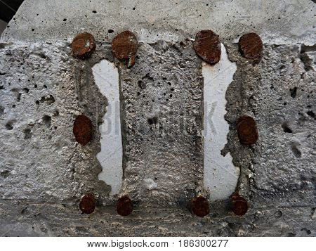Steel Or Iron Rod In Concrete Mass, Detail On Construction Site. Casted Railway Ties