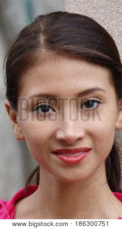 A Portrait of a  Hispanic Female Smiling
