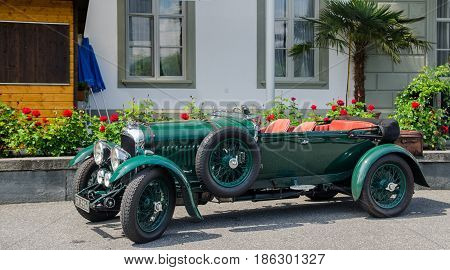 LUCERNE, SWITZERLAND - JUNE 12, 2013: Vintage oldtimer Bentley Speed 6 parked on Lucerne street