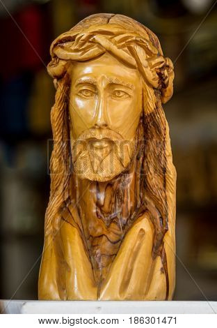 NAZARETH, ISRAEL - DECEMBER 11: The wooden carved sculpture of the Jesus Christ with crown of thorns in Nazareth, Israel on December 11, 2016
