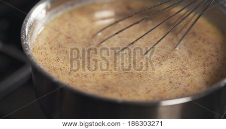 preparing bechamel sauce with spices mixing, 4k photo