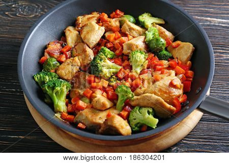 Chicken stir fry in pan, closeup