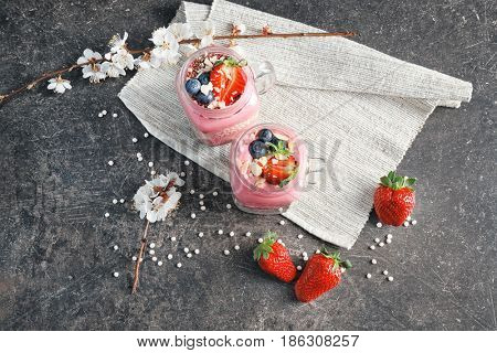 Delicious parfait with fruits in jar on table