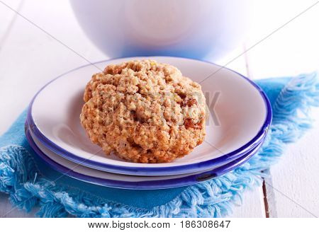Oat and raisin biscuits in a mug