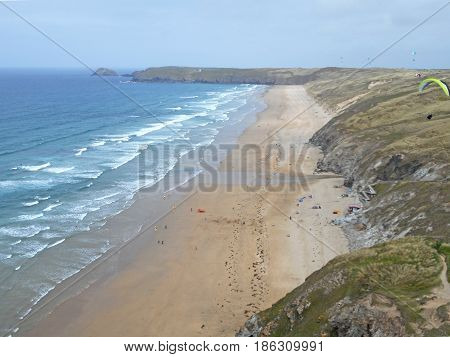 Paragliders high above Perranporth beach in Cornwall