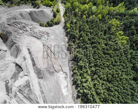 Border Between Industial Site And Gree Forest. Aerial View Of Open Pit Sand.