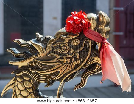 Golden Lion With Red Bow