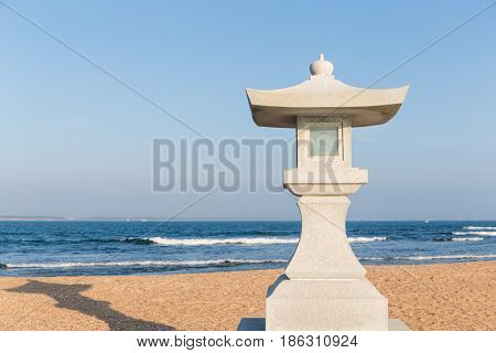 Japanese temple with stone lantern in the beach