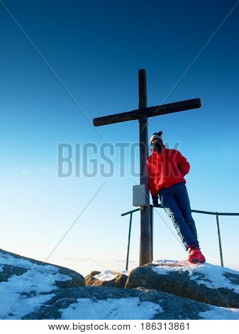 Tourist In Winter Clothes On Summit  With Crucifix