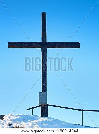 Sharp Summit  With Modest Cross Raised  On Mountain Peak.
