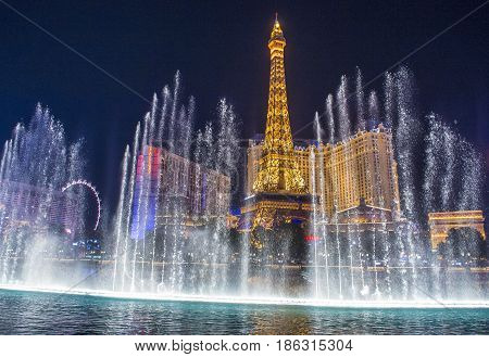 LAS VEGAS - OCT 05 : Night view of the dancing fountains of Bellagio and the Eiffel Tower replica of Paris hotel in Las Vegas Nevada on October 05 2016