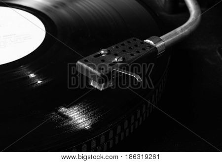 Black vinyl on the record player. CloseUp