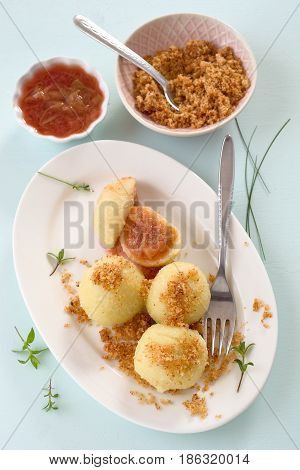 Dumpling with plum and buttered bread crumbs
