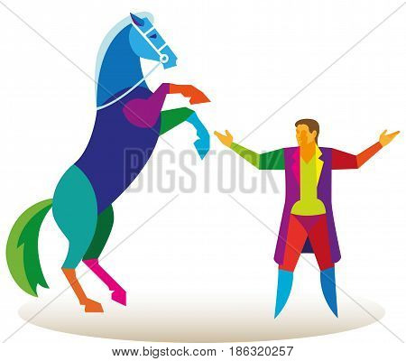 The horse stands on its hind legs in front of the trainer in the circus arena