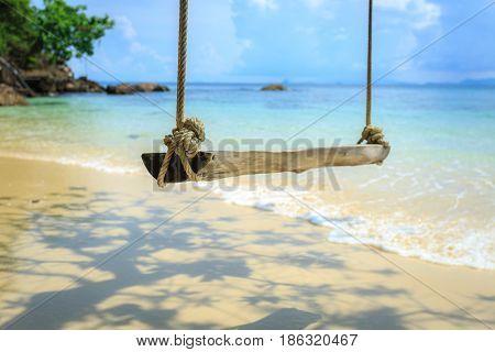Swing hanging under the tree at mai-ton island Phuket Thailand beach