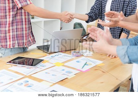 Two Start Up Young People Shaking Hands After Meeting While Their Colleagues Applauding - Teamwork B