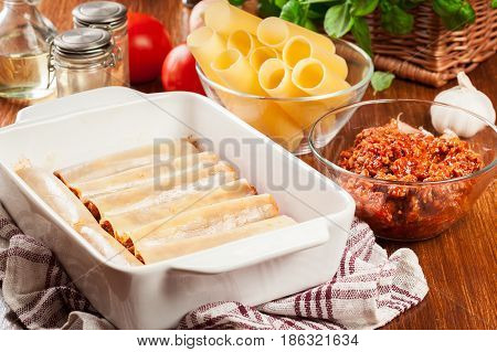 Cannelloni Stuffed With Meat Cooked In A Casserole Dish Ready For Baking