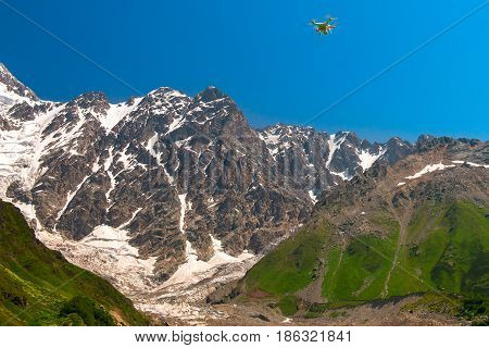DJI Phantom 2 Vision+ standard quad-copter flying into Caucasus mountains in Georgian Svaneti region. Beautiful large glacier
