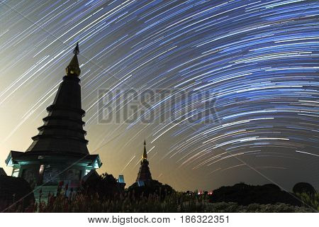 Night Sky With Star Trail And Two Pagoda In Doi Inthanon Mountain, Natural Astronomy Landscape