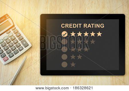 excellent five stars credit rating on tablet with soft light vintage effect