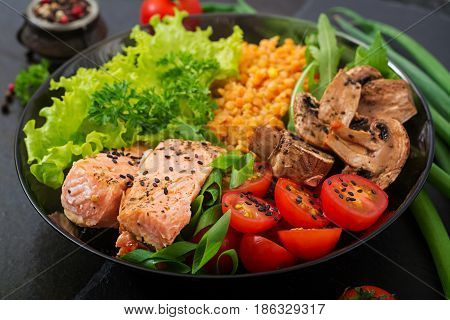 Healthy Salad With Salmon, Tomatoes, Mushrooms, Lettuce And Lentil On Dark Background