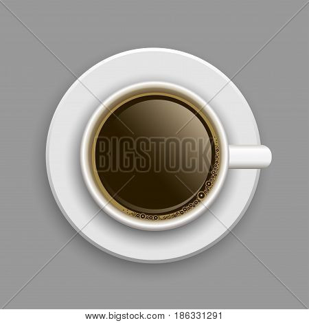 White cup of coffee above on plate with shadow on gray background. Hot drink