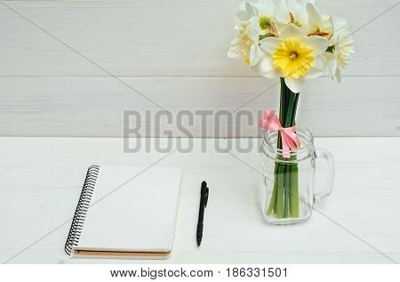 Yellow Bouquet Of Narcissus In Vase On White Wooden Background. Blank Card Flat Lay. Top View On Tab