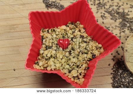 Hemp seeds/ This is a hemp seeds  in red star bowls.