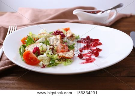 Portion of salad and cranberry sauce on plate