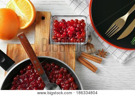 Delicious cranberry sauce on kitchen table