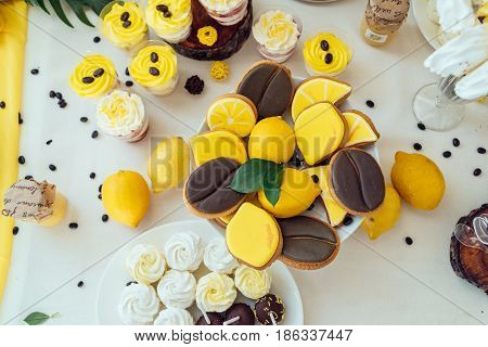 Holiday Candy Bar In Yellow And Brown Color. Wedding Candy Bar Served With Lemon Biscuits, Cake Pops