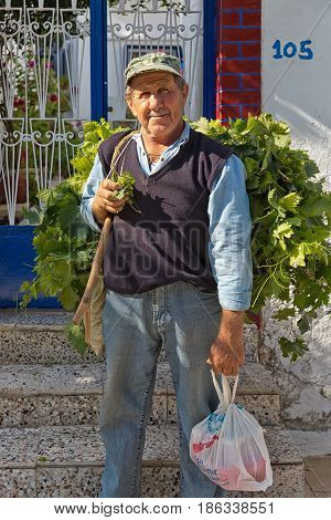Amorgos Island Greece - October 2015: Greek man posing.The people in Greece are affraid how the Greek debt crisis has his impact on there lives and work