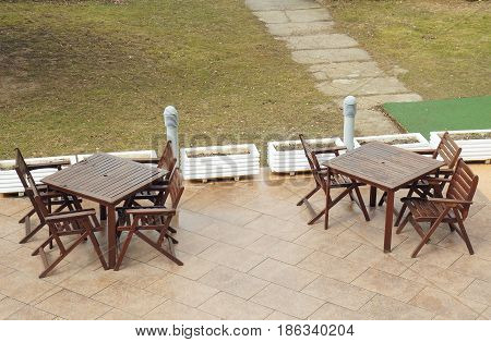 Winter near Mavrovo lake in Macedonian republic, two tables outside