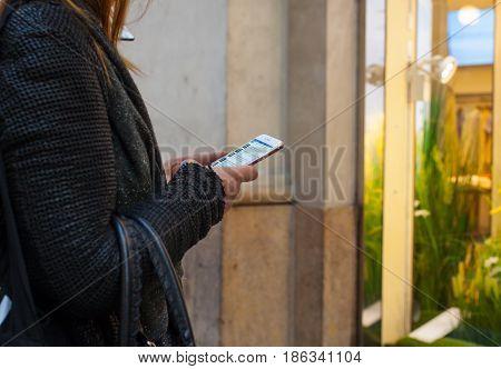 MILAN ITALY - FEBRUARY 26: Girl using her smarthphone on february 26 2017