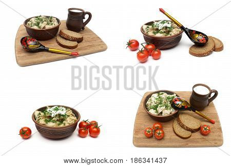 Dumplings with meat in a plate on a cutting board on a white background. Horizontal photo.