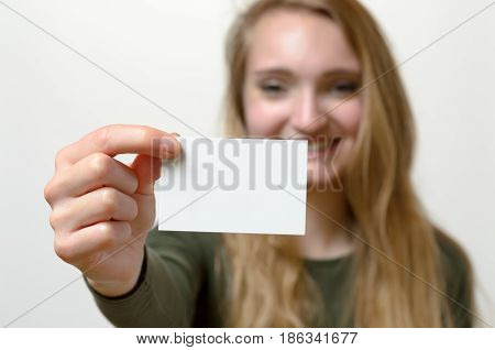 Attractive Blond Woman With Her Business Card