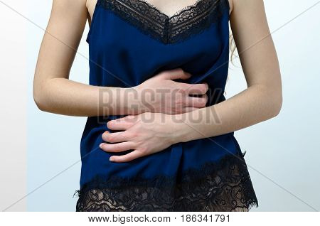 Woman In Nightie Holding Her Stomach