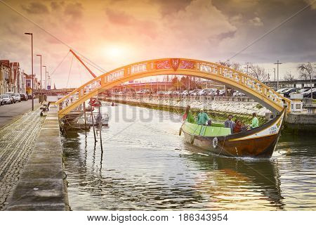 Aveiro, Portugal - March 21, 2017: The Vouga River With Bridge And Traditional Boat