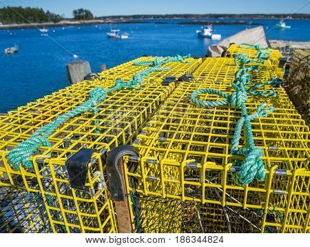 Lobster traps at a fishing pier in coastal Maine New England