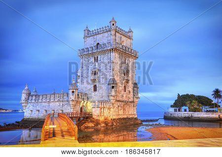 Lisbon ancient Belem Tower at sunrise. Portugal