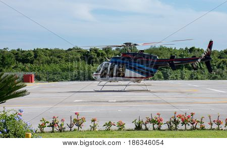 Helicopter Ready To Take Off From The Helipad