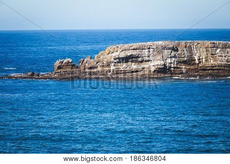 Rocky outcropping jutting out into the Pacific Ocean.
