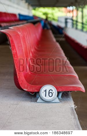 The empty and old plastic seats in the grandstand.