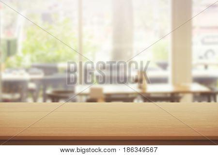 Close up of empty wooden desktop. Cafe exterior background. Mock up