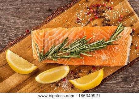 Delicious portion of fresh salmon fillet with aromatic herbs